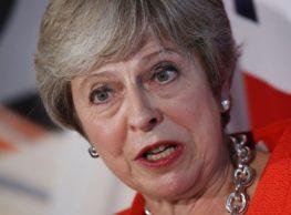 Theresa May In  Brexit No Deal Corridor